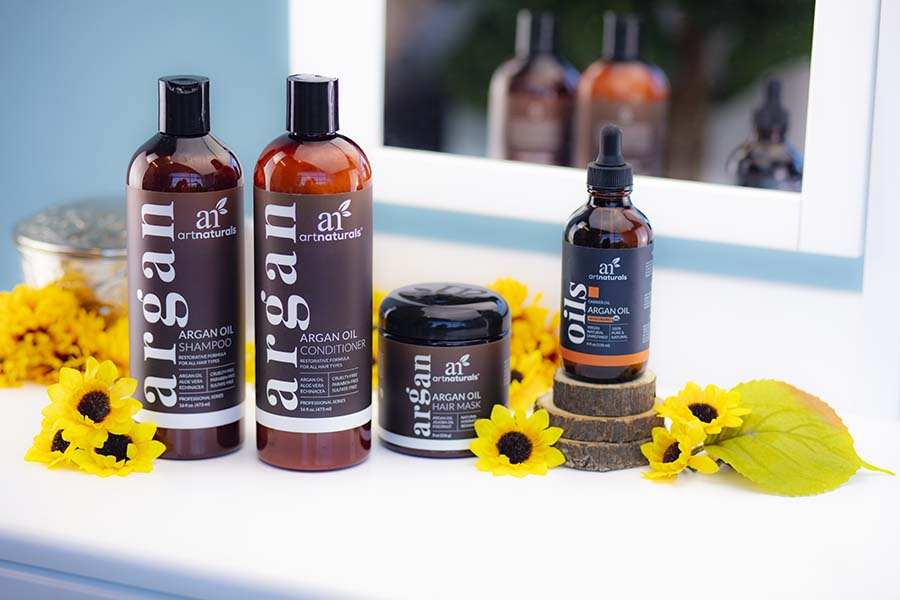 argan-oil-hair-care-collection-arranged-on-vanity-with-yellow-daisies