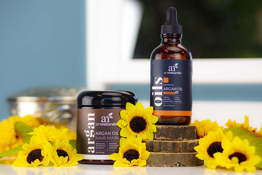 best-argan-oil-products-for-deep-conditioning-artistically-arranged-with-yellow-flowers