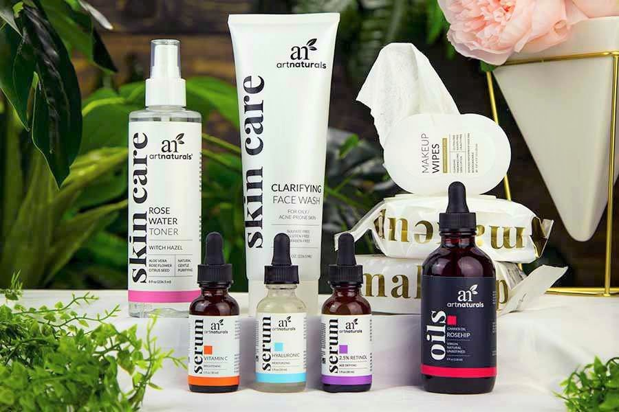 skin-care-gift-set-products-on-table-with-christmas-lights-and-decor