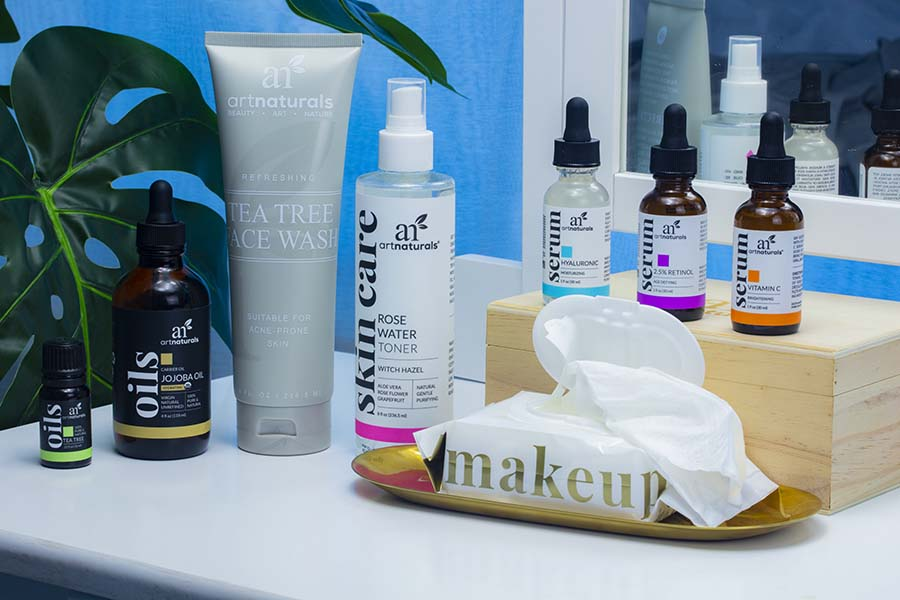 natural-skin-care-products-for-bedtime-routine-on-counter-with-mirror