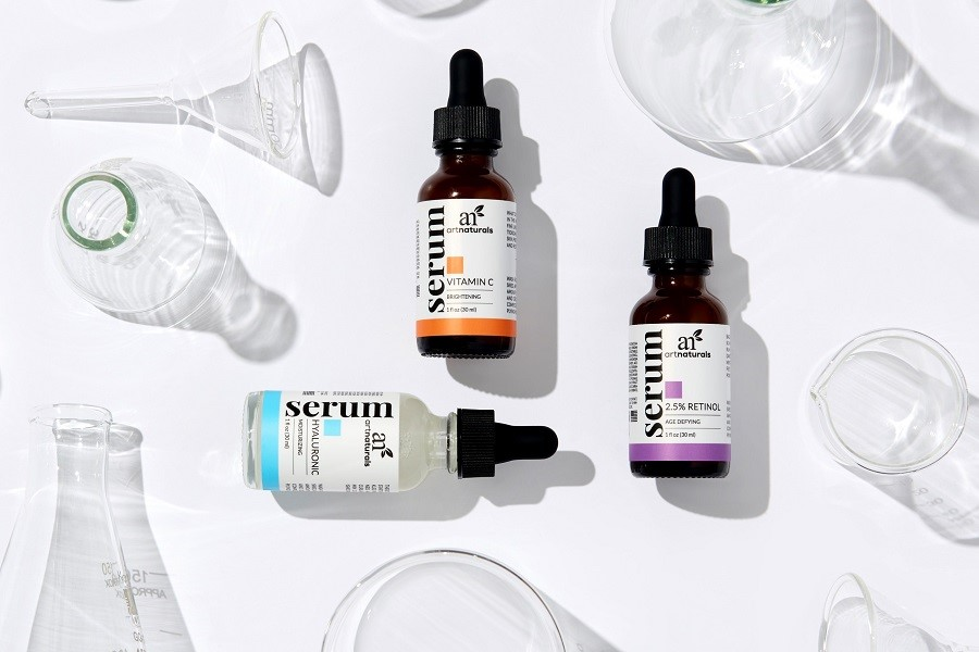 face-serums-for-skin-care-on-white-table-with-beakers-and-glassware
