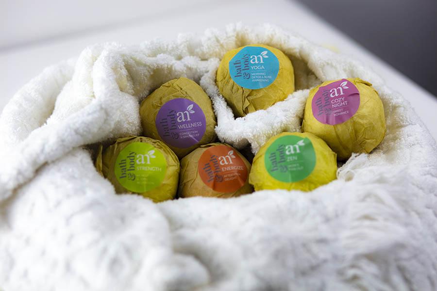 artnaturals-essential-oil-bath-bombs-on-sink-nestled-in-white-bath-towel