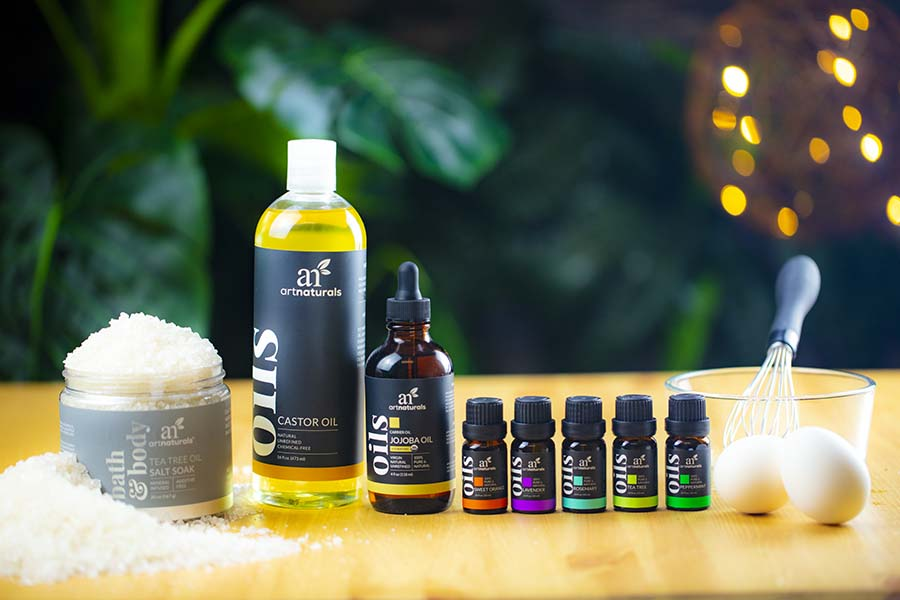 ingredients-for-castor-oil-and-essential-oils-DIY-massage-recipe-artistically-arranged-on-a-wooden-table