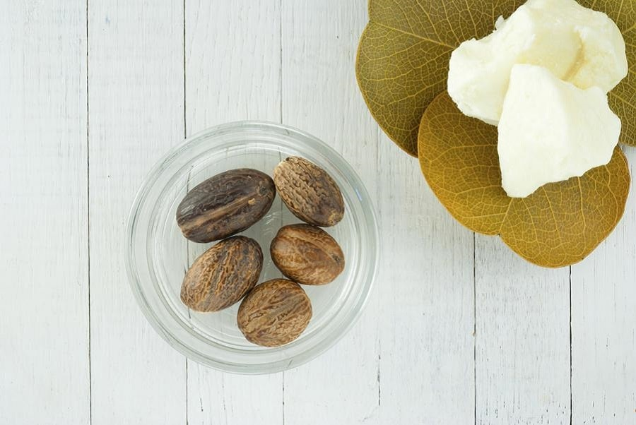 raw-african-shea-butter-and-nuts-on-vintage-white-washed-wooden-table