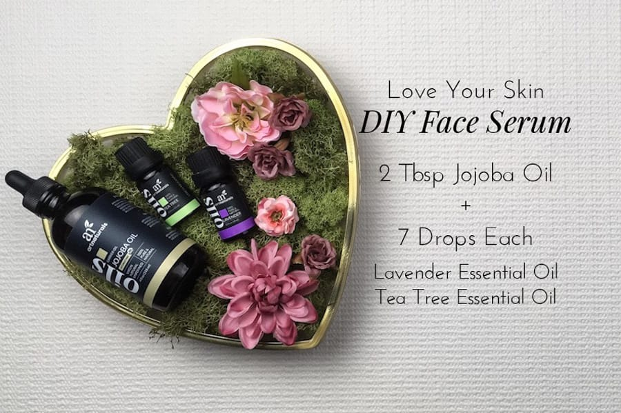 diy-essential-oil-face-serum-recipe-with-pink-flowers-and-moss-for-vday